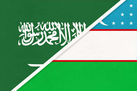 Saudi Arabia and Uzbekistan, symbol of national flags from textile. Relationship, partnership and championship between two Asian countries. 版權商用圖片