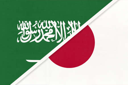 Saudi Arabia and Japan, symbol of national flags from textile. Relationship, partnership and championship between two Asian countries.