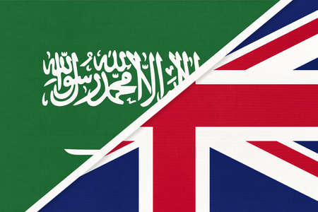 Saudi Arabia and United Kingdom of Great Britain or UK, symbol of two national flags from textile. Relationship, partnership and championship between Asian and European countries.