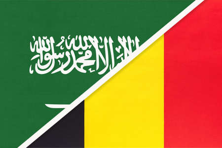 Saudi Arabia and Belgium, symbol of two national flags from textile. Relationship, partnership and championship between Asian and European countries.