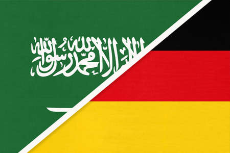 Saudi Arabia and Germany, symbol of two national flags from textile. Relationship, partnership and championship between Asian and European countries. 版權商用圖片