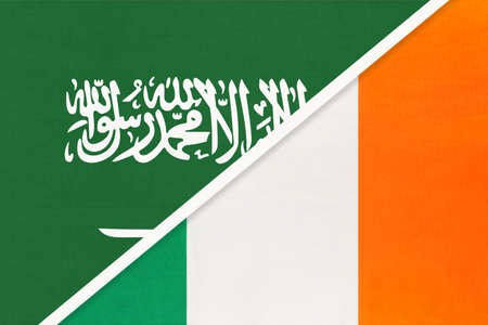 Saudi Arabia and Ireland, symbol of two national flags from textile. Relationship, partnership and championship between Asian and European countries.