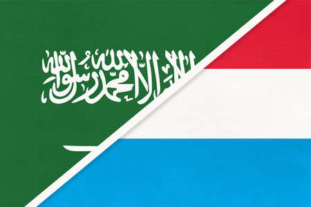 Saudi Arabia and Luxembourg, symbol of two national flags from textile. Relationship, partnership and championship between Asian and European countries.