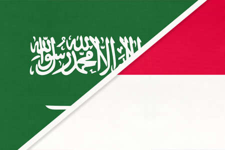 Saudi Arabia and Monaco, symbol of two national flags from textile. Relationship, partnership and championship between Asian and European countries.