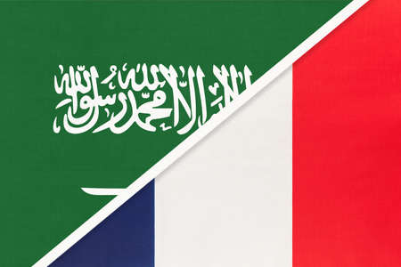 Saudi Arabia and France or French Republic, symbol of two national flags from textile. Relationship, partnership and championship between Asian and European countries. 版權商用圖片