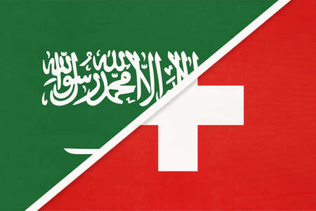 Saudi Arabia and Switzerland or Swiss Confederation, symbol of two national flags from textile. Relationship, partnership and championship between Asian and European countries. 版權商用圖片