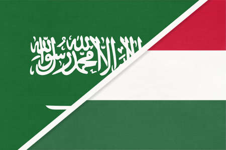Saudi Arabia and Hungary, symbol of two national flags from textile. Relationship, partnership and championship between Asian and European countries.