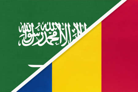 Saudi Arabia and Romania, symbol of two national flags from textile. Relationship, partnership and championship between Asian and European countries.