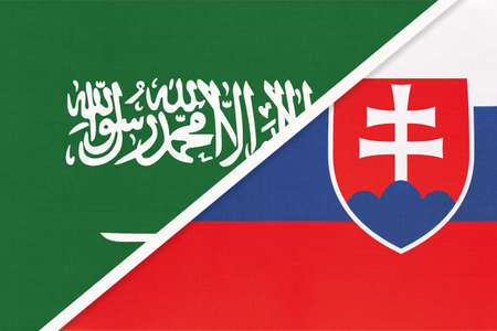 Saudi Arabia and Slovakia or Slovak Republic, symbol of two national flags from textile. Relationship, partnership and championship between Asian and European countries. Banco de Imagens