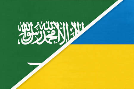 Saudi Arabia and Ukraine, symbol of two national flags from textile. Relationship, partnership and championship between Asian and European countries. Banco de Imagens