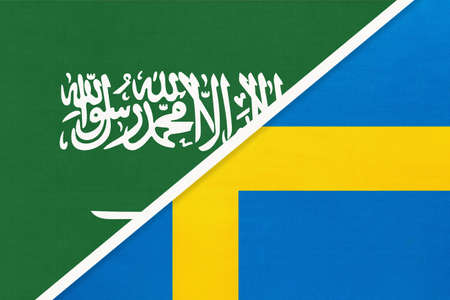 Saudi Arabia and Sweden, symbol of two national flags from textile. Relationship, partnership and championship between Asian and European countries. Banco de Imagens