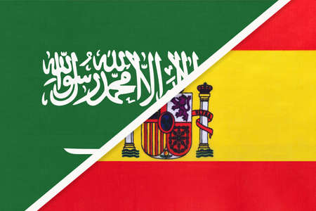 Saudi Arabia and Spain, symbol of two national flags from textile. Relationship, partnership and championship between Asian and European countries.