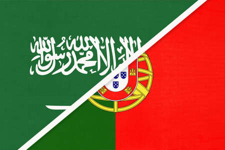 Saudi Arabia and Portugal or Portuguese Republic, symbol of two national flags from textile. Relationship, partnership and championship between Asian and European countries.