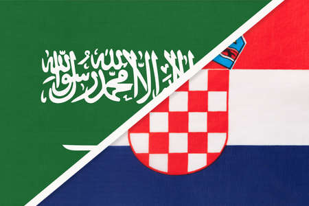 Saudi Arabia and Croatia, symbol of two national flags from textile. Relationship, partnership and championship between Asian and European countries. Banco de Imagens