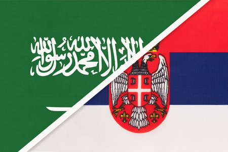 Saudi Arabia and Serbia, symbol of two national flags from textile. Relationship, partnership and championship between Asian and European countries.