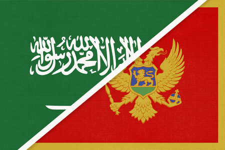 Saudi Arabia and Montenegro, symbol of two national flags from textile. Relationship, partnership and championship between Asian and European countries. Banco de Imagens