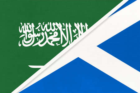 Saudi Arabia and Scotland, symbol of two national flags from textile. Relationship, partnership and championship between Asian and European countries.