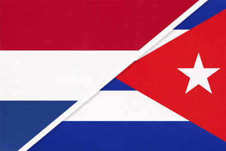 Netherlands or Holland and Cuba, symbol of national flags from textile. Relationship, partnership and championship between European and American countries.