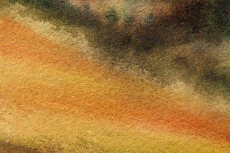 Abstract art background dark orange and black colors. Watercolor painting on canvas with soft yellow gradient. Fragment of artwork on paper with pattern. Texture backdrop. Archivio Fotografico