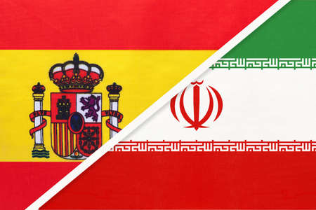 Spain and Iran or Persia, symbol of two national flags from textile. Relationship, partnership and championship between European and Asian countries.
