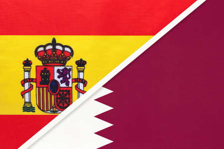 Spain and Qatar, symbol of two national flags from textile. Relationship, partnership and championship between European and Asian countries. Archivio Fotografico