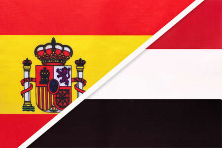 Spain and Yemen, symbol of two national flags from textile. Relationship, partnership and championship between European and Asian countries.
