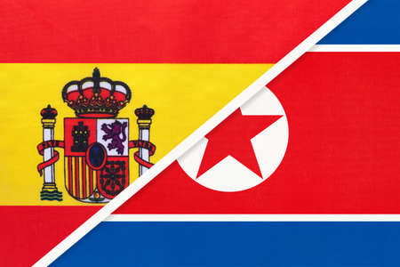 Spain and North Korea or DPRK, symbol of two national flags from textile. Relationship, partnership and championship between European and Asian countries. Archivio Fotografico