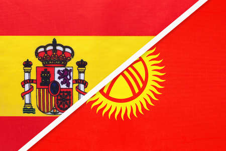 Spain and Kyrgyzstan or Kyrgyz Republic, symbol of two national flags from textile. Relationship, partnership and championship between European and Asian countries.