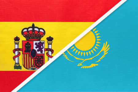 Spain and Kazakhstan, symbol of two national flags from textile. Relationship, partnership and championship between European and Asian countries. Archivio Fotografico