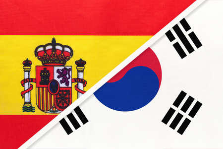 Spain and South Korea or ROK, symbol of two national flags from textile. Relationship, partnership and championship between European and Asian countries.
