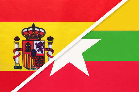 Spain and Myanmar or Burma, symbol of two national flags from textile. Relationship, partnership and championship between European and Asian countries.