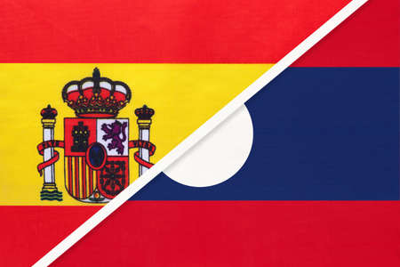 Spain and Laos, symbol of two national flags from textile. Relationship, partnership and championship between European and Asian countries. Archivio Fotografico