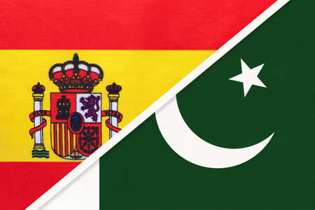 Spain and Pakistan, symbol of two national flags from textile. Relationship, partnership and championship between European and Asian countries.