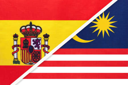 Spain and Malaysia, symbol of two national flags from textile. Relationship, partnership and championship between European and Asian countries.