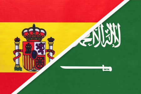 Spain and Saudi Arabia, symbol of two national flags from textile. Relationship, partnership and championship between European and Asian countries.