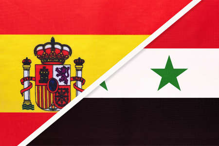 Spain and Syrian Arab Republic or Syria, symbol of two national flags from textile. Relationship, partnership and championship between European and Asian countries. Archivio Fotografico