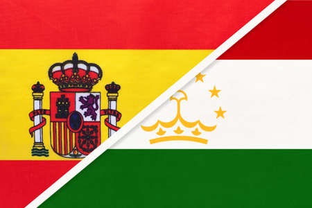 Spain and Tajikistan, symbol of two national flags from textile. Relationship, partnership and championship between European and Asian countries.
