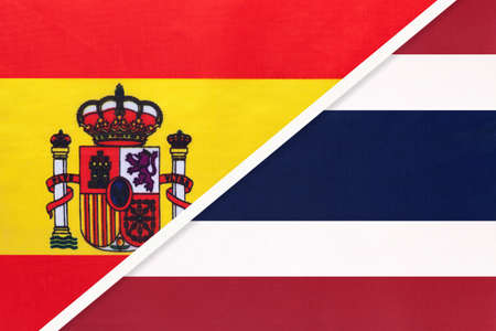 Spain and Thailand or Siam, symbol of two national flags from textile. Relationship, partnership and championship between European and Asian countries. Archivio Fotografico