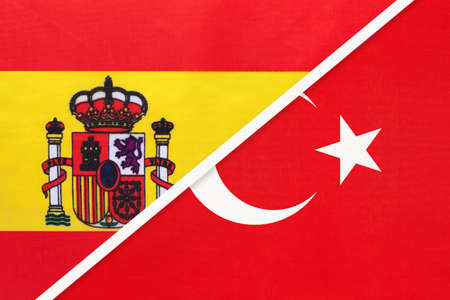 Spain and Turkey, symbol of two national flags from textile. Relationship, partnership and championship between European and Asian countries. Archivio Fotografico