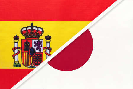 Spain and Japan, symbol of two national flags from textile. Relationship, partnership and championship between European and Asian countries.