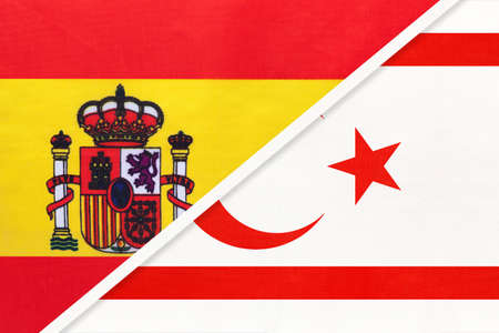 Spain and Northern Cyprus or TRNC, symbol of two national flags from textile. Relationship, partnership and championship between European and Asian countries.
