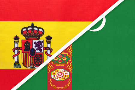 Spain and Turkmenistan or Turkmenia, symbol of two national flags from textile. Relationship, partnership and championship between European and Asian countries.