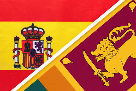 Spain and Sri Lanka, symbol of two national flags from textile. Relationship, partnership and championship between European and Asian countries. Archivio Fotografico