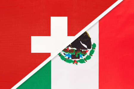 Switzerland or Swiss Confederation and Mexico or United Mexican States, symbol of national flags from textile. Relationship, partnership and championship between European and American countries. Archivio Fotografico