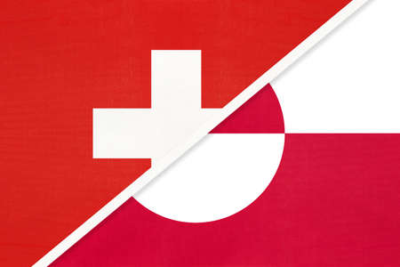 Switzerland or Swiss Confederation and Greenland, symbol of national flags from textile. Relationship, partnership and championship between European and American countries. Archivio Fotografico