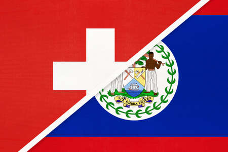 Switzerland or Swiss Confederation and Belize, symbol of national flags from textile. Relationship, partnership and championship between European and American countries. Archivio Fotografico