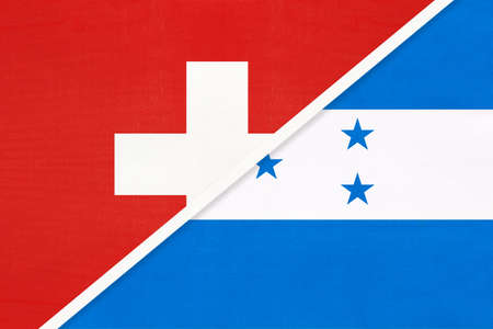 Switzerland or Swiss Confederation and Honduras, symbol of national flags from textile. Relationship, partnership and championship between European and American countries.