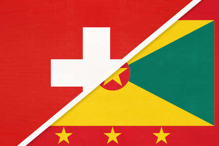 Switzerland or Swiss Confederation and Grenada, symbol of national flags from textile. Relationship, partnership and championship between European and American countries.