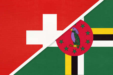 Switzerland or Swiss Confederation and Dominica, symbol of national flags from textile. Relationship, partnership and championship between European and American countries. Archivio Fotografico