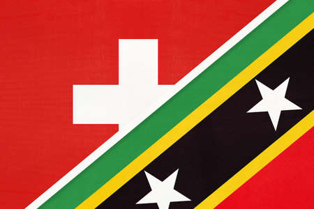 Switzerland or Swiss Confederation and Saint Kitts and Nevis, symbol of national flags from textile. Relationship, partnership and championship between European and American countries. Archivio Fotografico